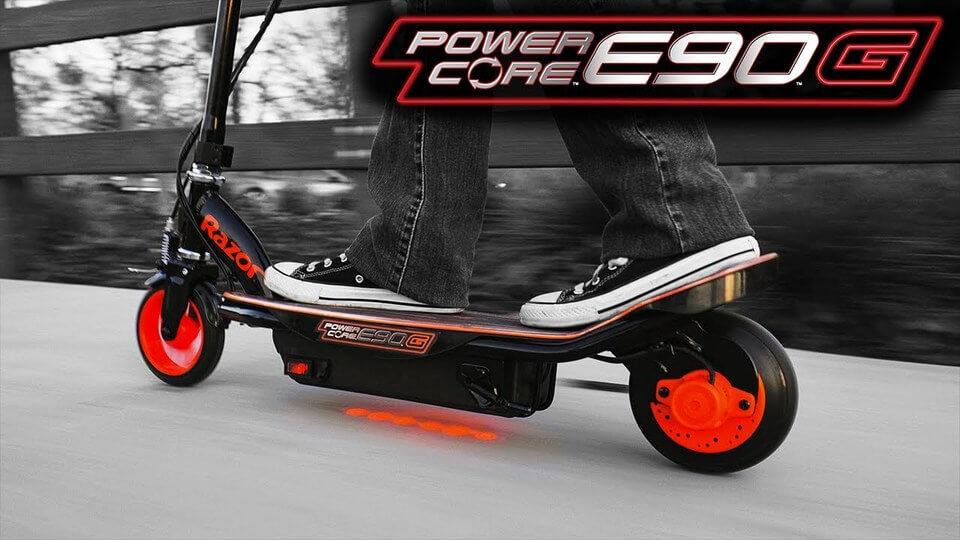 child riding the E90 glow by Razor