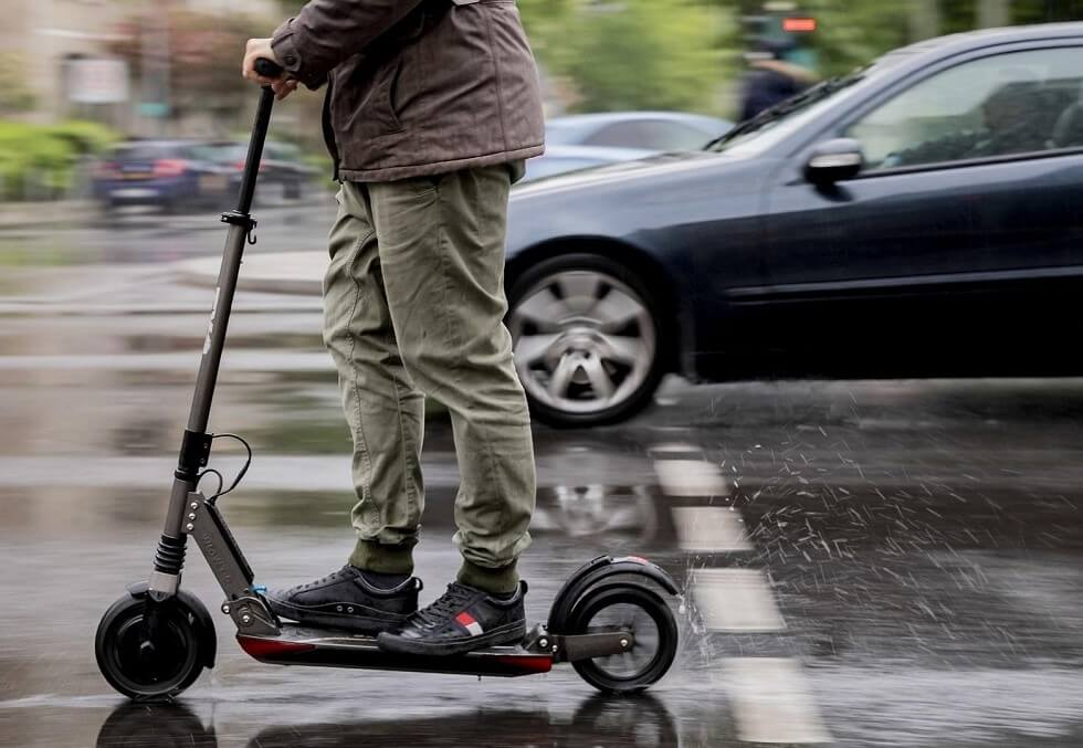 Man riding the Segway Max in wet road conditions