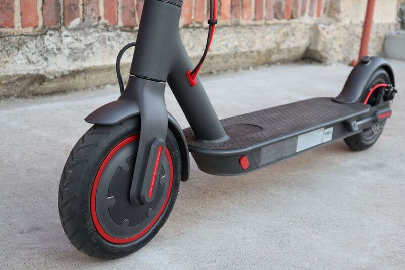 Xiaomi specs with matte grey with red wheel trim and deck