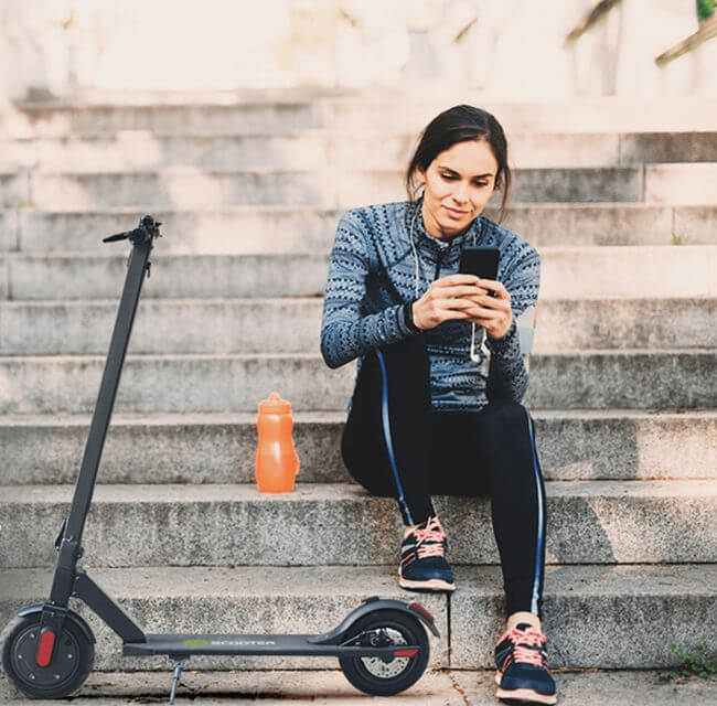 women sat on a step next to her power scooter
